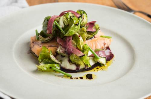 Bacon-Poached Arctic Char with Onion Puree and Brussels Sprout Salad